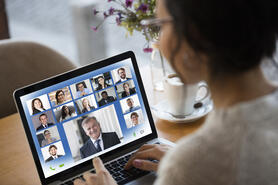 Woman attending a zoom meeting with clients.